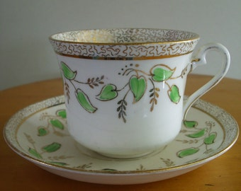 Hand Painted Phoenix Tea Cup and Saucer