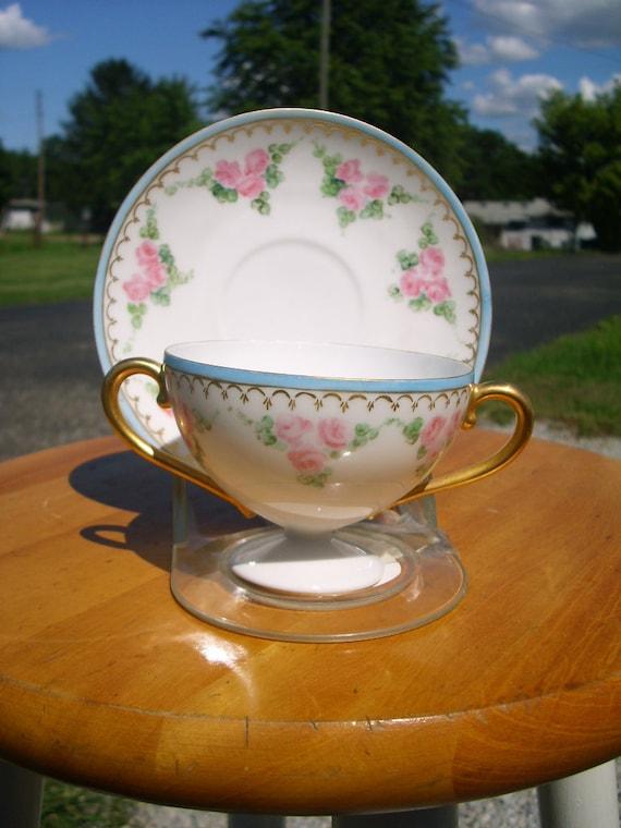Two Handle Tea Cup and Saucer 50% 0ff