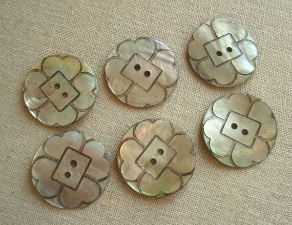 Abalone shell buttons, carved flower motif