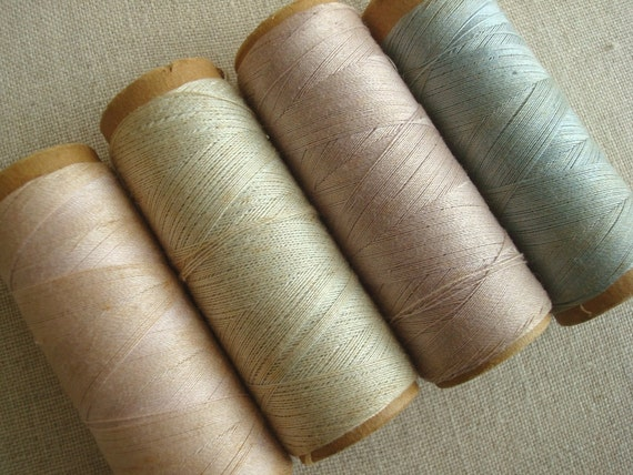 Cardboard thread spools, old bobbins, pale dusty colors