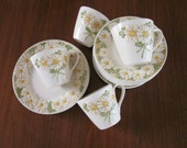 "Metlox ""Sculptured Daisy"" Poppytrail Dinnerware - California Pottery (1964) Plates, Bowls, Cups, Saucers"