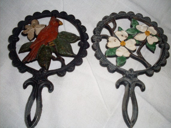 Pair of decorative cast iron trivets