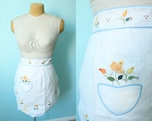 vintage 70s appliqued apron NOS unused // floral // white blue and yellow