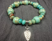 Aqua Serpentinite Jasper & Ceramic Beadwork Gemstone Bracelet With Feather Charm