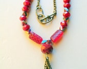 red art nouveau necklace with tassel