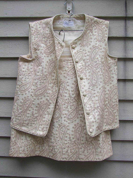 Matching mini skirt and vest embroidered leather like and lined ala 1960s free shipping Continental U.S. through march 15th