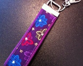 Purple corduroy print key fob wristlet on purple cotton webbing with swivel lobster clasp