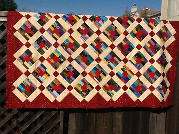 Red and cream patch work quilt top