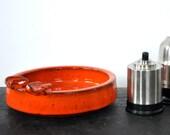 Big orange ceramic ashtray