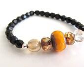Pumpkin and Black Czech Glass Beaded Bracelet