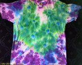 adult XL tie-dye T-shirt with turquoise and green star-bursts on an indigo and purple ground