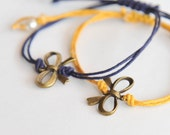 Wish friendship bracelet with perfect bows on waxed cord - purple, yellow // lasting bows
