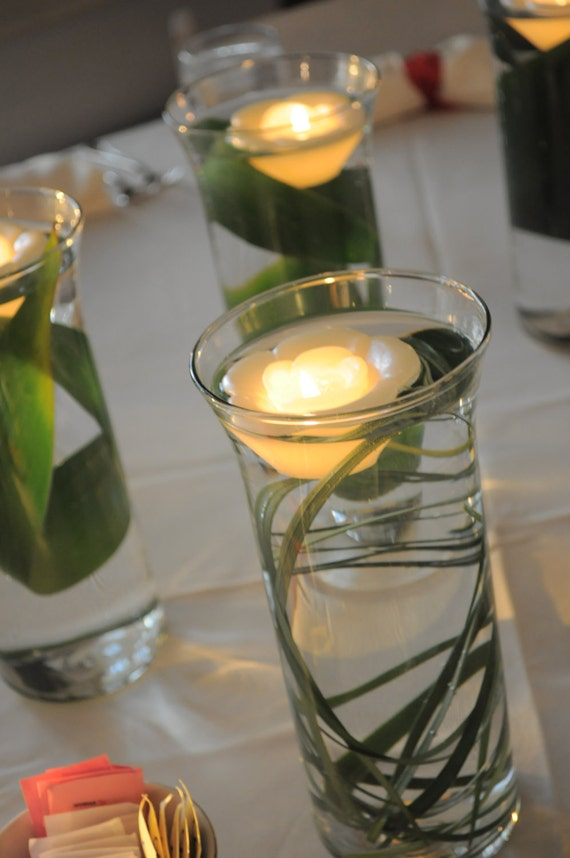 Items similar to leaf and floating candle wedding