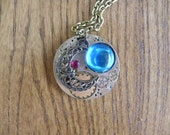Pendant Steampunk Style with a Brass Necklace, Genuine Vintage Watch Part and a Faceted Ruby