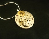Pendant Steampunk Style with a Brass Necklace, Genuine Vintage Watch Movement and Faceted Rubies