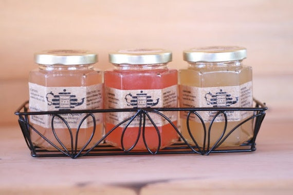 Gift set of 3 Organic flavored honey with wire gift basket. Choose your flavors. 8 oz size. Organic Herbs and Raw Honey.