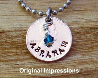 """Custom family penny coin jewelry pendant necklace of a genuine U.S. penny with a Swarovski """"birth month"""" crystal on a stainless steel chain."""