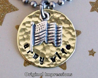 Army wife pendant necklace of hammered brass decorated with a sterling silver American flag charm on a stainless steel chain.