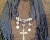 Scarf. Jewelry. Necklace. Cross. Pendant. Gray. Silver. Accessories. Rhinestones.