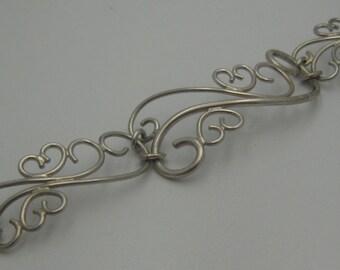 Silver scroll bracelet