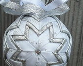 Silver snowflakes on white ribbon quilted ornament