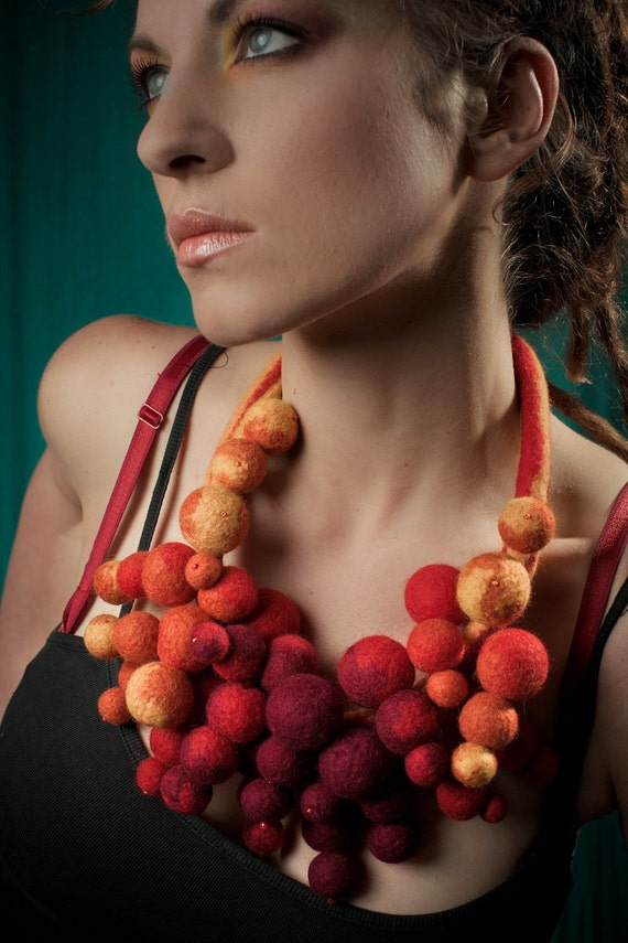 Felted necklace made of yellow, orange, red and purple balls