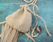 leather medicine bag with cowry shell and fringe