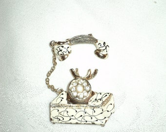 The BELLS ARE RINGING,  A Vintage Pin of an Old Telephone made of White Painted Enamel on Gold Leaf metal base with Rhinestones