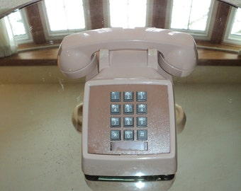 Vintage Touch tone Telephone in boring beige plastic color in working condition with the pound and star sign available in Vintage Condition