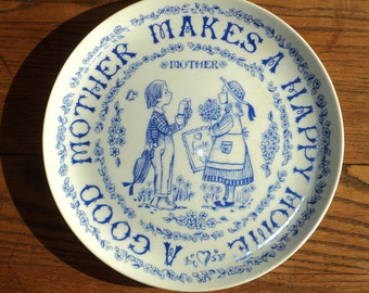 "Vintage Blue and White Ware Wall Plate which states "" A good Mother Makes a Happy Home""  for wall display and for mother's everywhere"