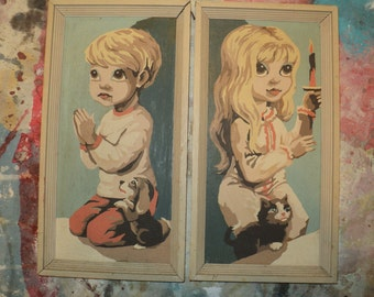 2 Vintage  Paint by Number paintings of  of a Boy and Girl kneeling in prayer with wonderful doe shaped eyes in Good Vintage Condition.