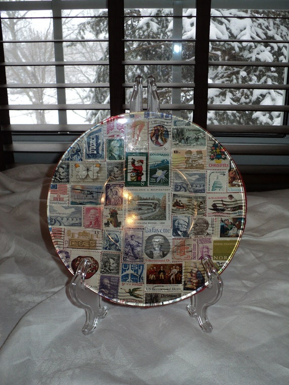 Vintage Stamp Collection displayed on the back of a glass Plate from various areas and eras