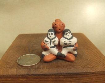 Native American Indian art sculpture - mini Zuni mud head story teller
