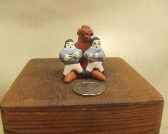 Native American Indian art sculpture - Zuni mud head story teller