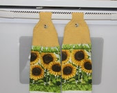 PRICE REDUCED Pair of sunflower motif kitchen towels w/crocheted Cornmeal yellow toppers & button closures w/sunflower design.
