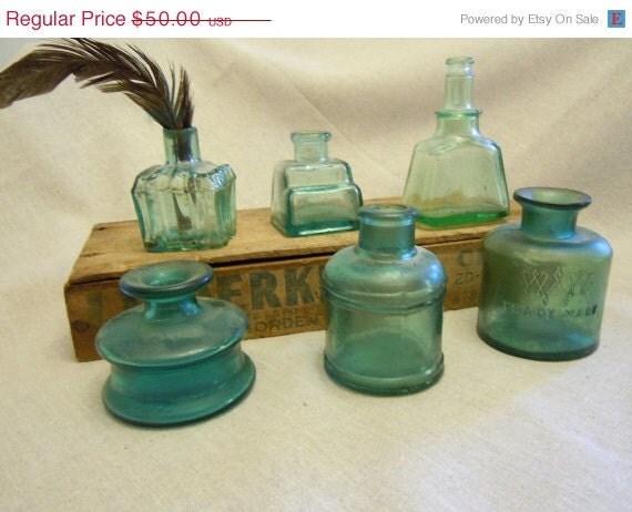 Teal antique ink bottles