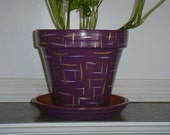 "HAND PAINTED POT 8""  done in artist's signature theme ""scratching post"""
