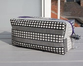 Black and white boxy toiletry bag made out of oilcloth