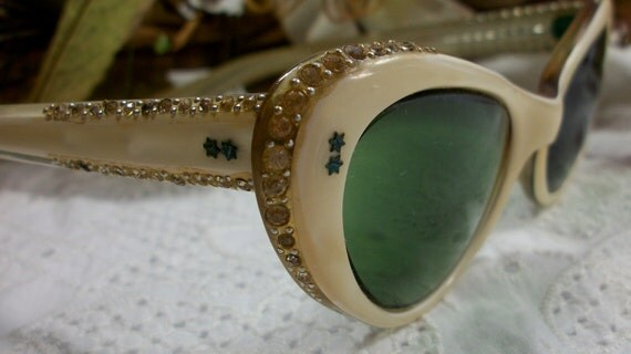 vintage cat eye sunglasses rhinestones and green lenses Possible bakelite or hard celluloid  frame script lenses   FREE SHIPPING  USA only.