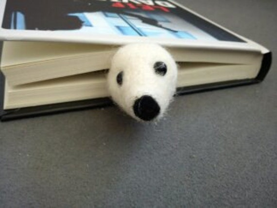 Needle felted baby seal bookmark with black beads as eyes