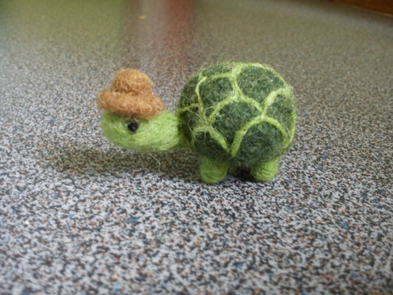 Needle felted miniature turtle with a brown hat