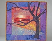 batik fabric quilted wall hanging with tree and sunset