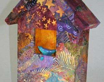 batik fabric bird house with clay bird and stars