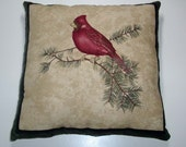 Cardinal Accent Pillow on a branch with pine needles