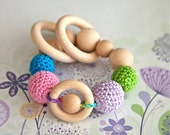 Teething rings toy rattle with crochet wooden beads and 3 wooden rings. Neon blue, lavender, neon green, pink.