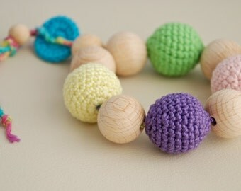 Teething toy with crochet wooden beads. Lilac, green, yellow, pink, blue.