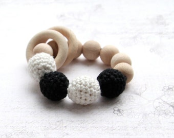 Black and white rattle. Monochrome, contrast toy. Teething ring toy with crochet wooden beads.