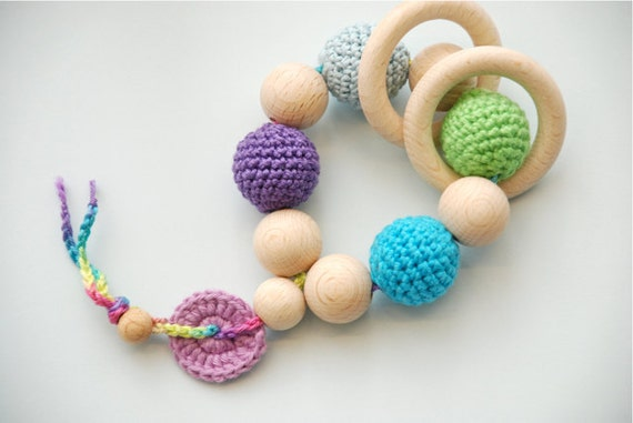 Teething toy rattle with crochet wooden beads and 2 wooden rings. Yellow, light blue, blue, green, violet, lilac/old rose.