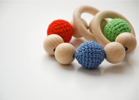 Teething toy with crochet wooden beads and 2 wooden rings. Red, green, blue wooden beads rattle.