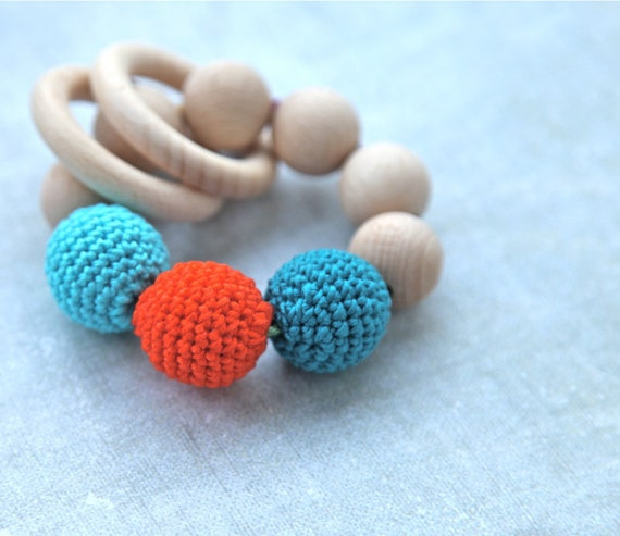 Teething toy with crochet teal, cyan/aqua, bright orange wooden beads and 2 wooden rings. Wooden rattle. Teething ring